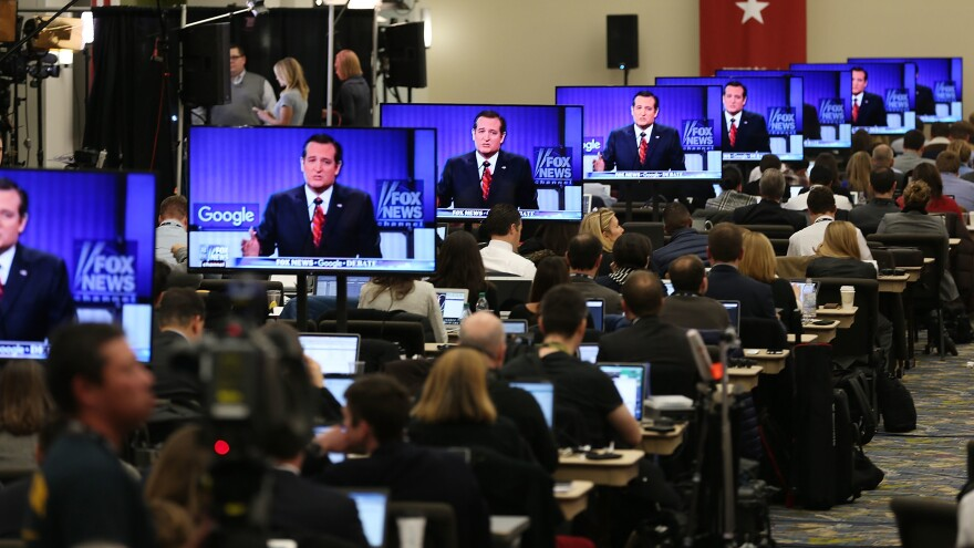 """Television screens are tuned to a Republican presidential debate sponsored by Fox News and Google in January 2016. """"People who get their news from Fox News actually take the strongest anti-immigrant position of any group we looked at in this survey,"""" one pollster says."""