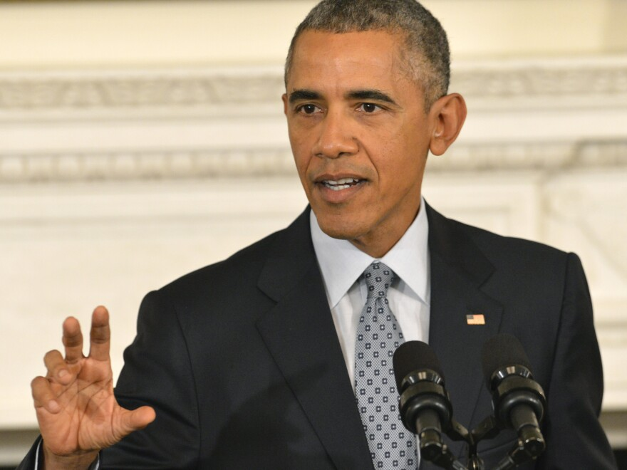 President Barack Obama responds to questions on Russia's intervention in Syria during a news conference in the State Dining Room of the White House, October 2, 2015, in Washington, D.C.