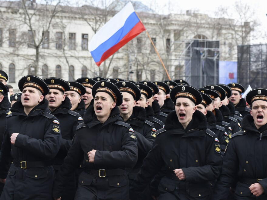 Russian Black Sea fleet sailors shout as they march in Sevastopol, Crimea, during a military parade last year marking the anniversary of the annexation of the Crimean Peninsula from Ukraine.