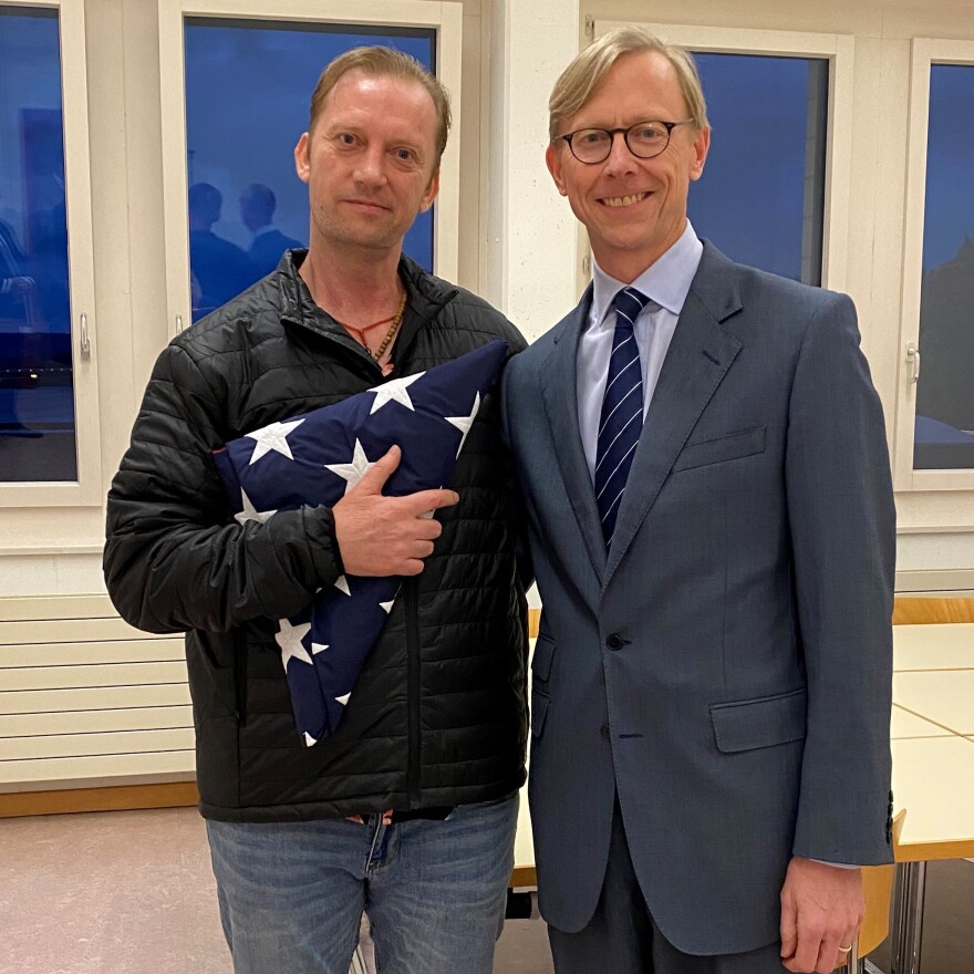 Michael White (left) meets Brian Hook, the U.S. special envoy for Iran, in Zurich, Switzerland, after White's release from detention in Iran.