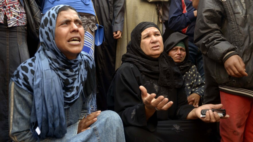 Relatives of defendants gather outside the courthouse in the central Egyptian city of Minya on Tuesday. Some 700 Islamists charged with deadly rioting were on trial. The day before, the court sentenced 529 men to death for killing a policeman.