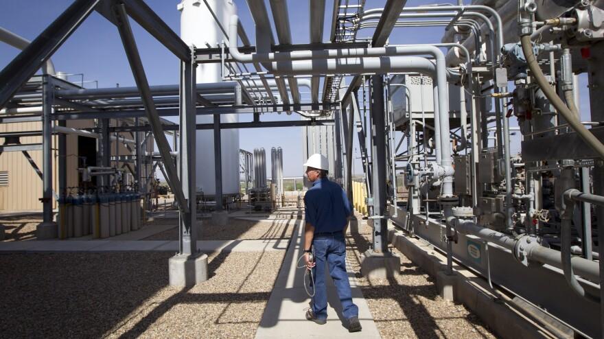 Deward Cawthon, a plant operator at the Federal Helium Reserve, walks through the Federal Crude Helium Enrichment Unit near Amarillo, Texas, in 2011.