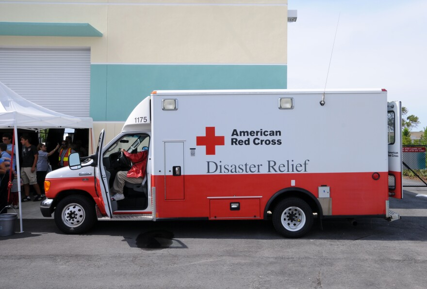 Photo of red cross truck.