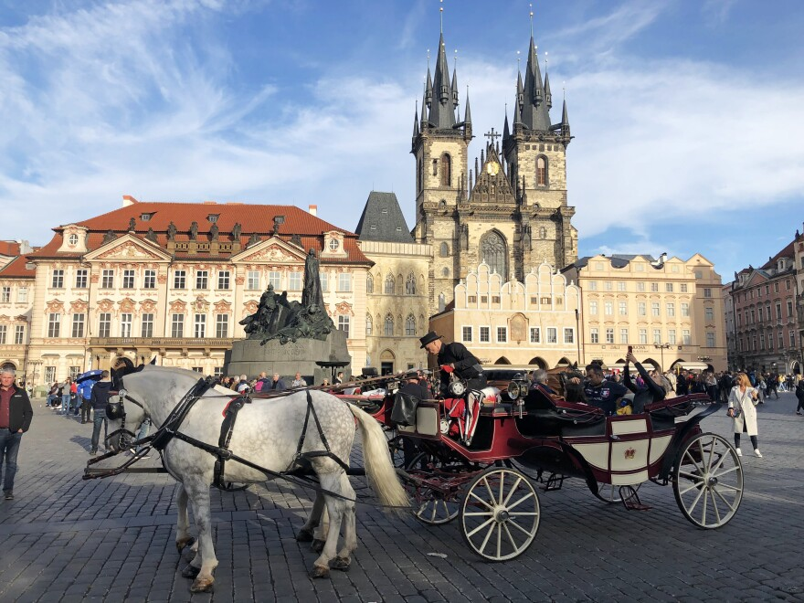 Tourists ride a horse-drawn carriage in Prague's old town square. The city is fighting Beijing's efforts to influence local politics and business interests.