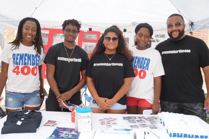 Members of the St. Louis Chapter of Remember the 400 attended the African Artifacts Festival on Saturday. Anthony Ross (right) said promoting African American history here brings hope to youth in the region. Aug 17, 2019