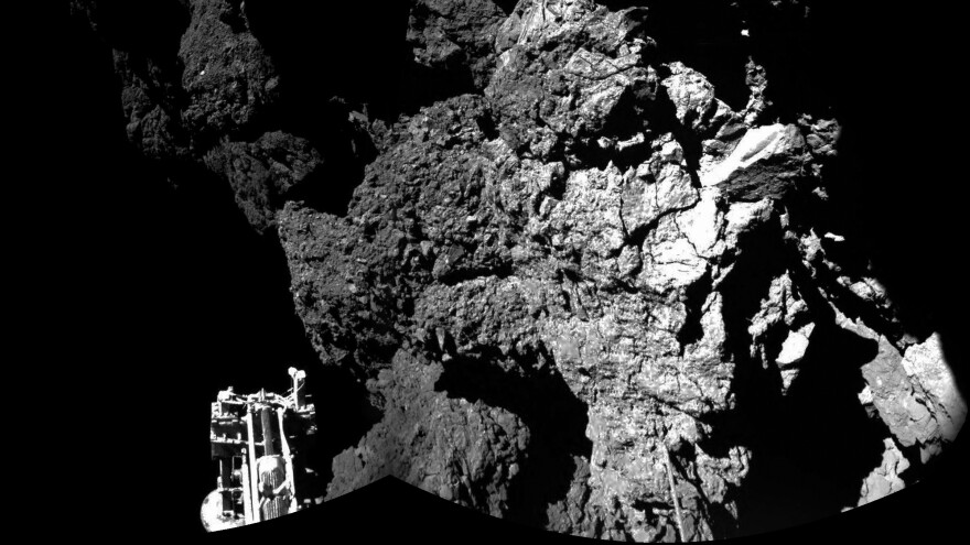 The Philae lander beamed back images showing one of its three feet on the surface of Comet 67P/Churyumov-Gerasimenko. This photo is compiled from two images.