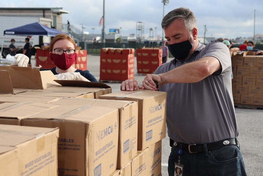 Brian Woods, NISD Superintendent, helping at a mass food distribution. NISD has regularly hosted mass distributions with the San Antonio Food Bank at the district's Gustafson Stadium.