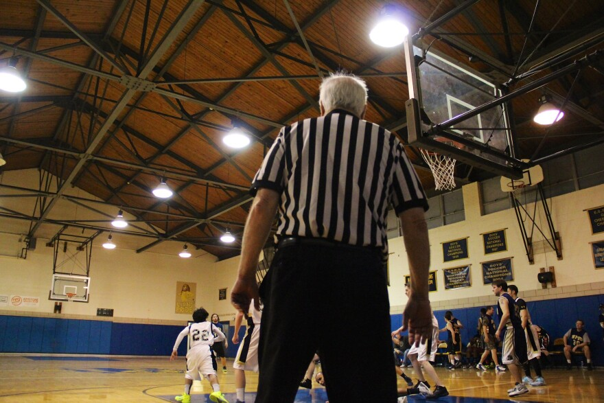 a photo of a referee at a basketball game