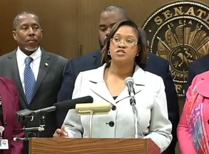 Rep. Mia Jones standing last week with members of the Florida Legislative Black Caucus, outlining their priorities.