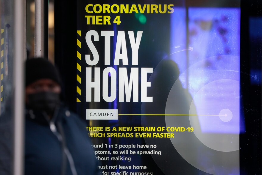 A poster about the new, fast-spreading variant of the novel coronavirus identified in the United Kingdom. The sign is displayed near King's Cross railway station in London.