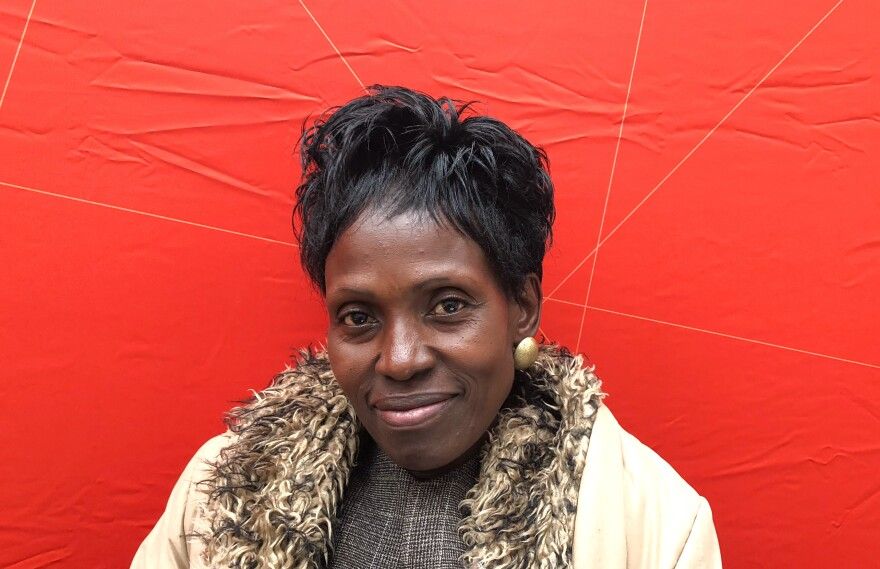 """Consolata Agunga goes door-to-door as a community health worker, a demanding volunteer job. """"It is God who gives me the strength,"""" she says. She is also a small-scale farmer, growing vegetables for her family."""