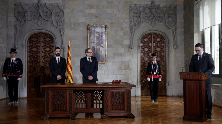 Newly appointed Catalan leader Quim Torra (center) and other Catalan officials at Torra's ceremonial swearing-in on Thursday. Torra avoided promising to obey the constitution.