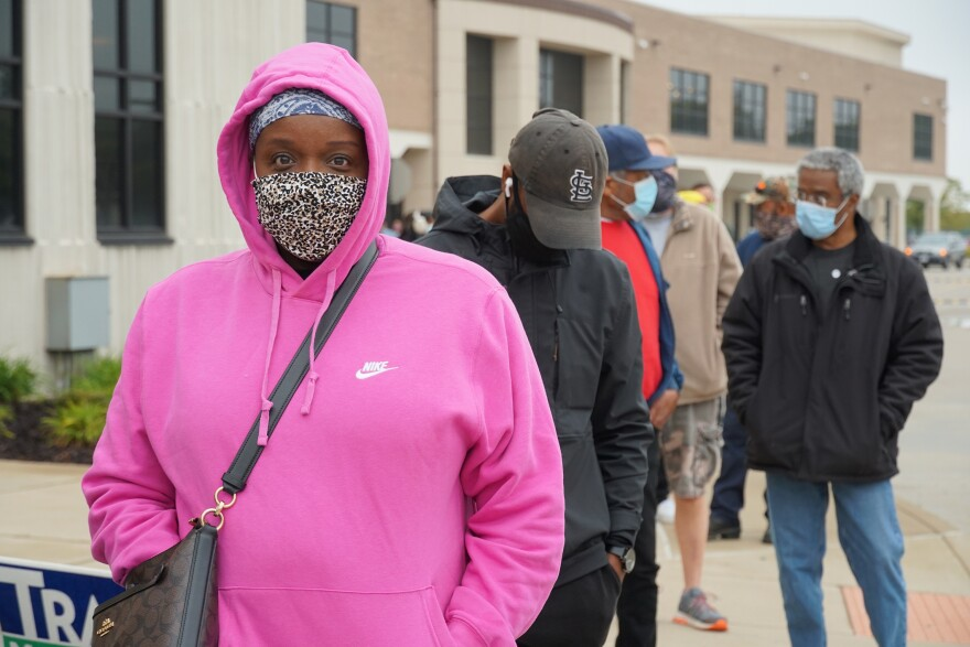 Kimberly Harper waits in line with others to vote early at Northwest Plaza in St. Ann on Oct 21, 2020.