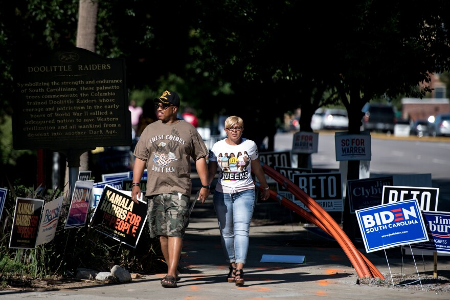 People walk down the sidewalk outside of Jim Clyburn's World-Famous Fish Fry. Unlike Iowa, New Hampshire, and Nevada, in South Carolina's Democratic primary, a majority of votes will be cast by African Americans.