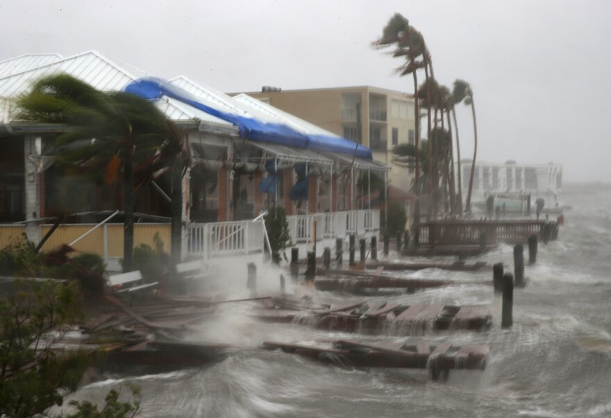 Heavy waves caused by Hurricane Matthew pound the boat docks at the Sunset Bar and Grill on Cocoa Beach, Fla., on Friday. Hurricane Matthew passed by offshore as a Category 3 hurricane, bringing heavy winds and minor flooding.