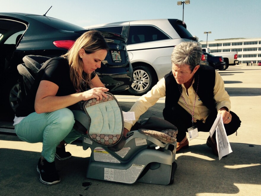 Petra Vybiralova, left, is a program supervisor at the Suncoast Safe Kids Coalition. She checks out a car seat with trainer Peggy Klimek.