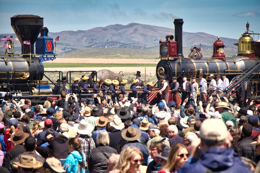 Photo of crowd and trains.