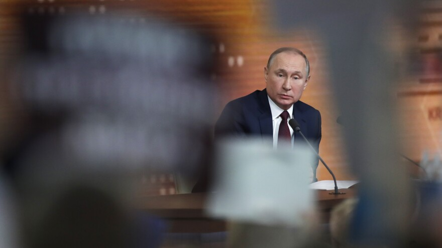 """Russian President Vladimir Putin speaks Thursday during his annual news conference in Moscow. During the four-hour session, the longtime Russian leader called the U.S. impeachment process """"far-fetched,"""" making the prediction that Donald Trump will be acquitted in the Senate."""
