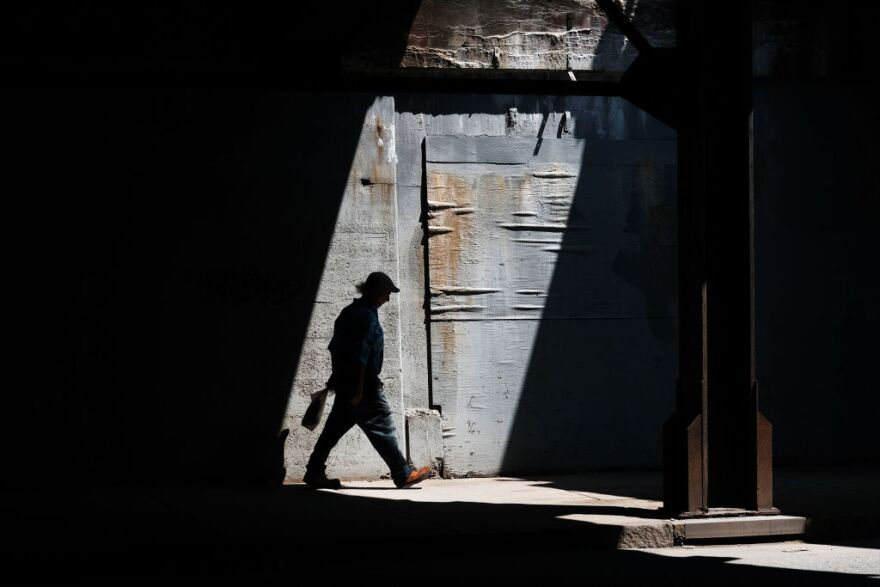A man walks along a street in Lawrence on August 16, 2019. (Spencer Platt/Getty Images)