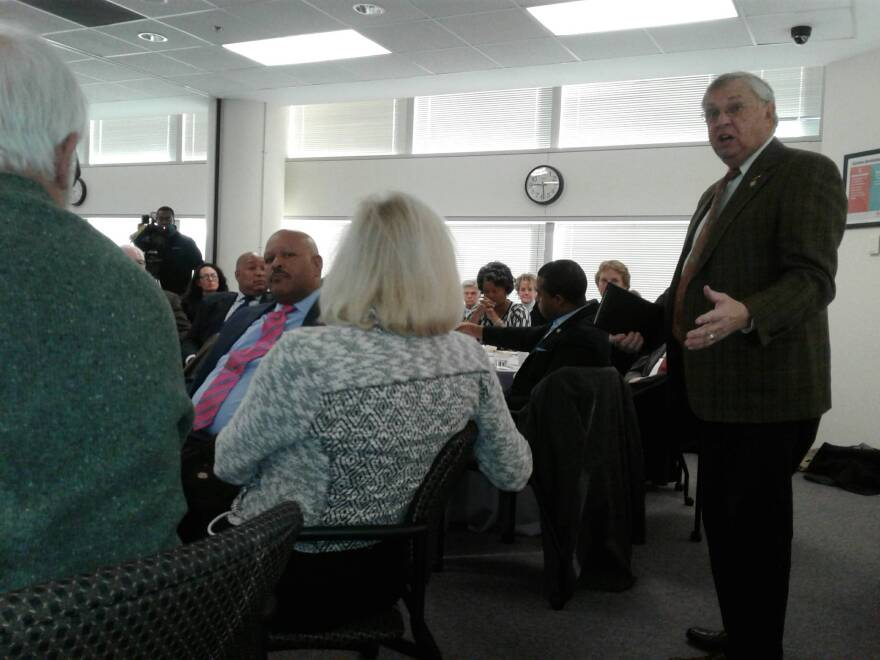 Union County Rep. Craig Horn (standing) talks to CMS officials at legislative breakfast about his efforts to tweak the reduced classroom size legislation for K-3.