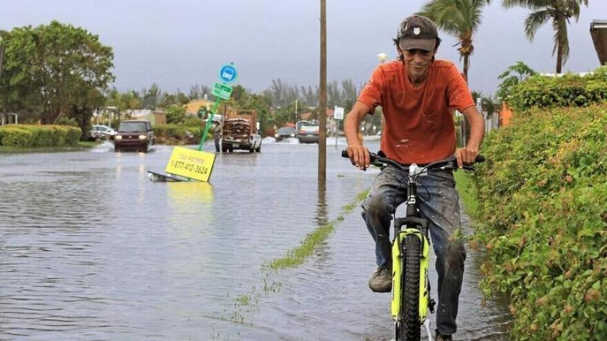 A biker rides through flooded Sweetwater streets in October, 2018.