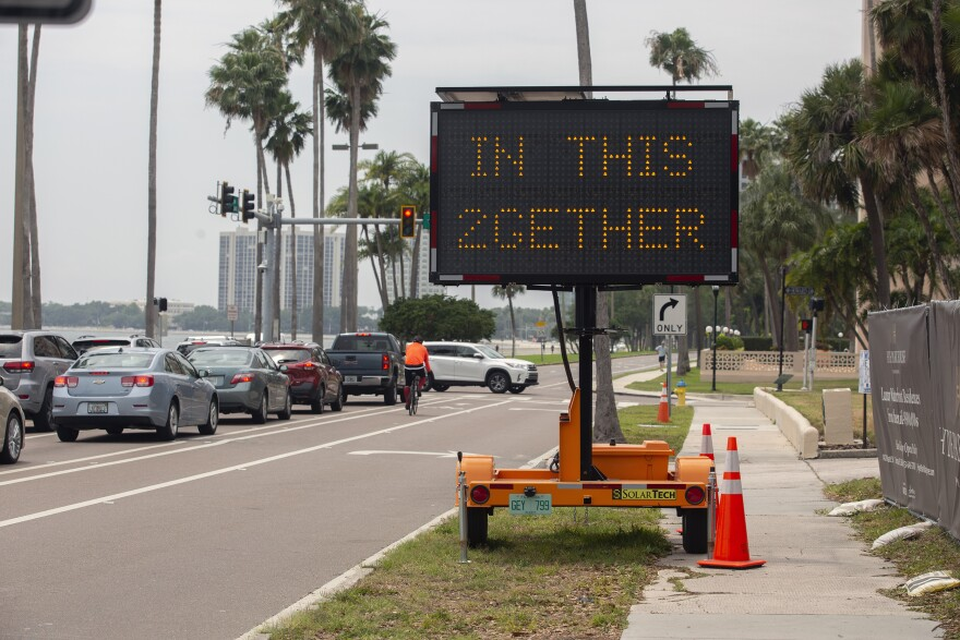 Sign on Bayshore Boulevard says Safer At Home