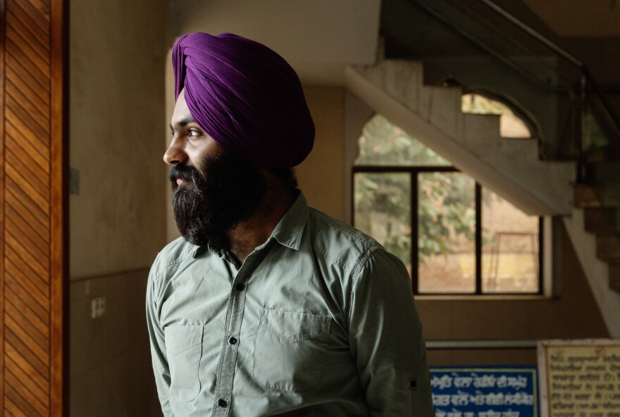 A member of Pakistan's tiny Sikh minority stops in Lahore's Gurudwara or Sikh temple.  Sikhs have a centuries-long presence in Lahore, but most fled for India in 1947.
