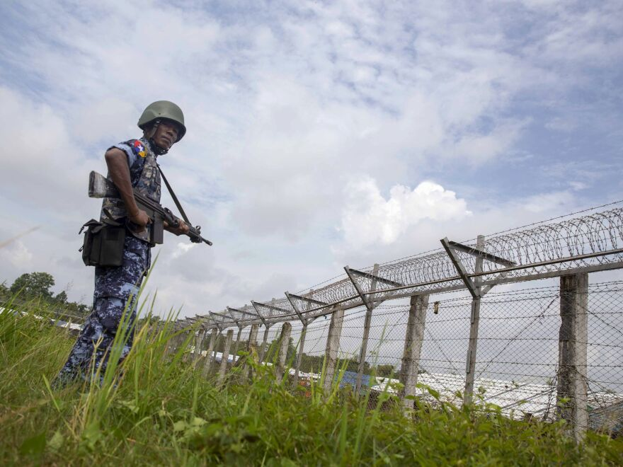 "Myanmar Border Guard Police in Rakhine state patrol the fence in the ""no-man's land"" zone between Myanmar and Bangladesh."