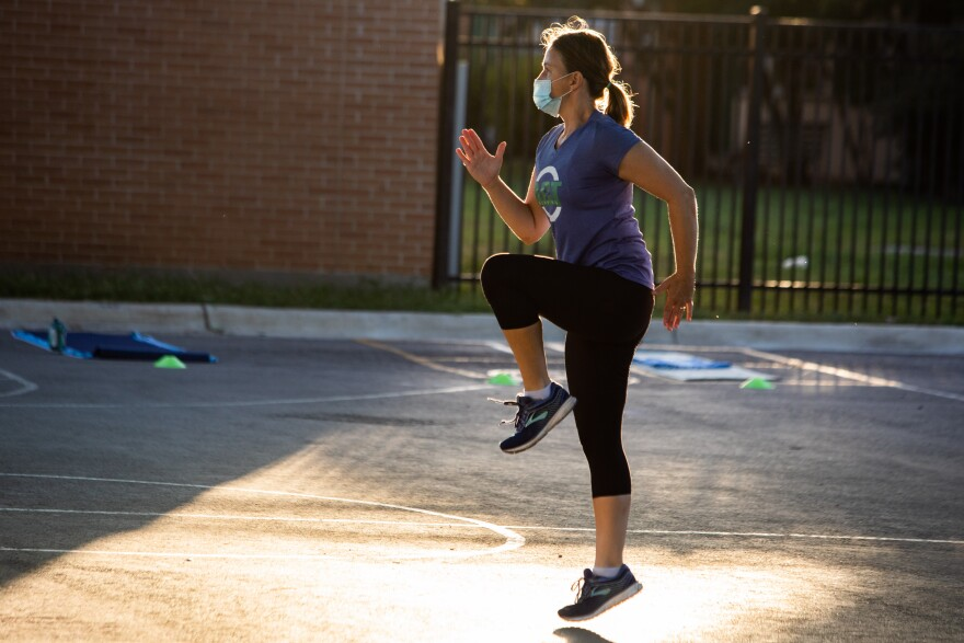 Ashley Thompson of ACT Running leads an exercise class at Highland Park Elementary School in July.