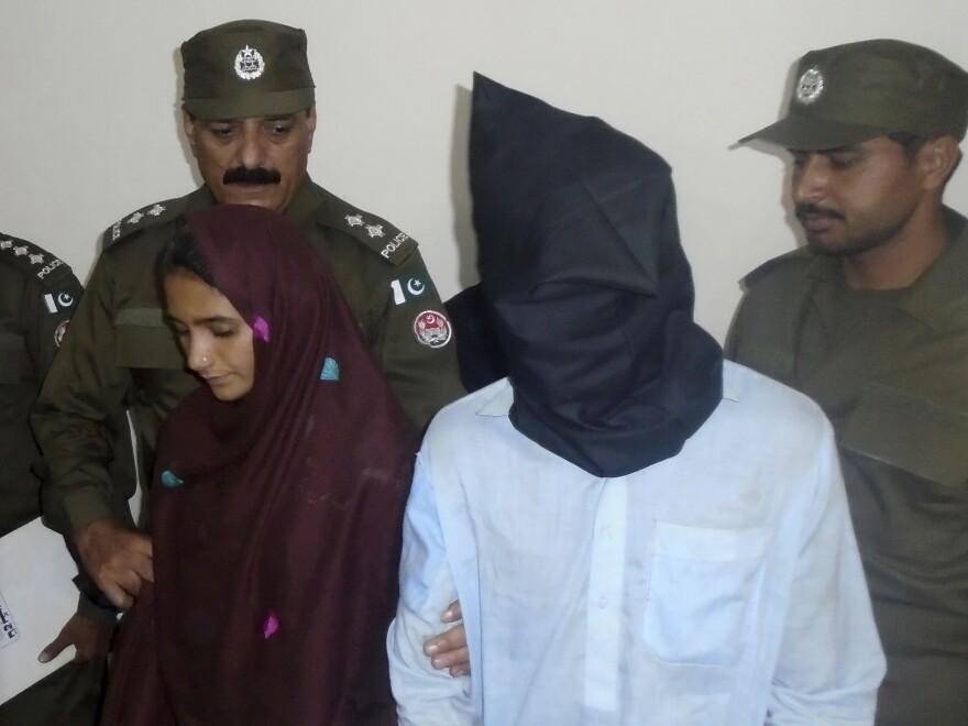 Aasia Bibi and her boyfriend, Shahid Lashari, are presented to journalists at a police station in Muzaffargarh, Pakistan, on Monday.