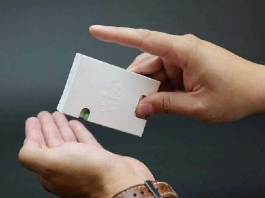 BillerudKorsnäs has designed their own version of a Tic Tac box, with a paper spring-loaded door that releases candy.