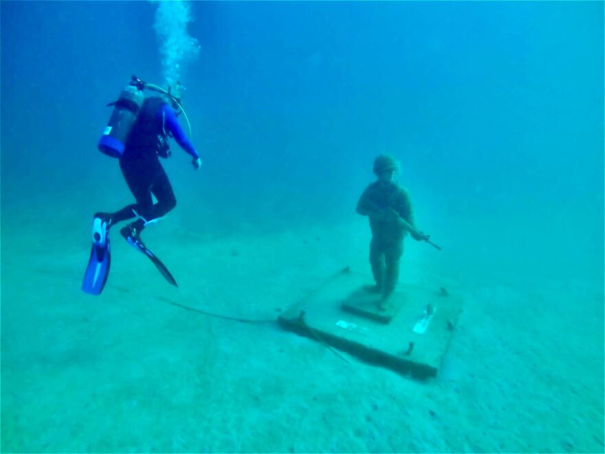 Air Force veteran Bob Herris explores the Circle of Heroes underwater military memorial off the coast of Clearwater.