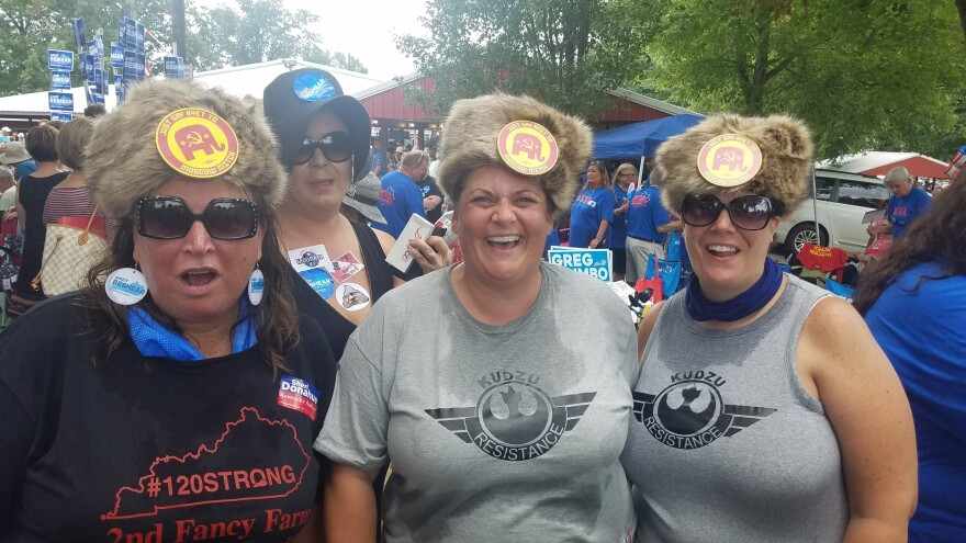"The August heat at a political event did not deter (from left) Laura Hartke, Christina Trosper and Katie Hancock from wearing their Russian-styled fur hat with buttons saying: ""Say Nyet To Moscow Mitch."""