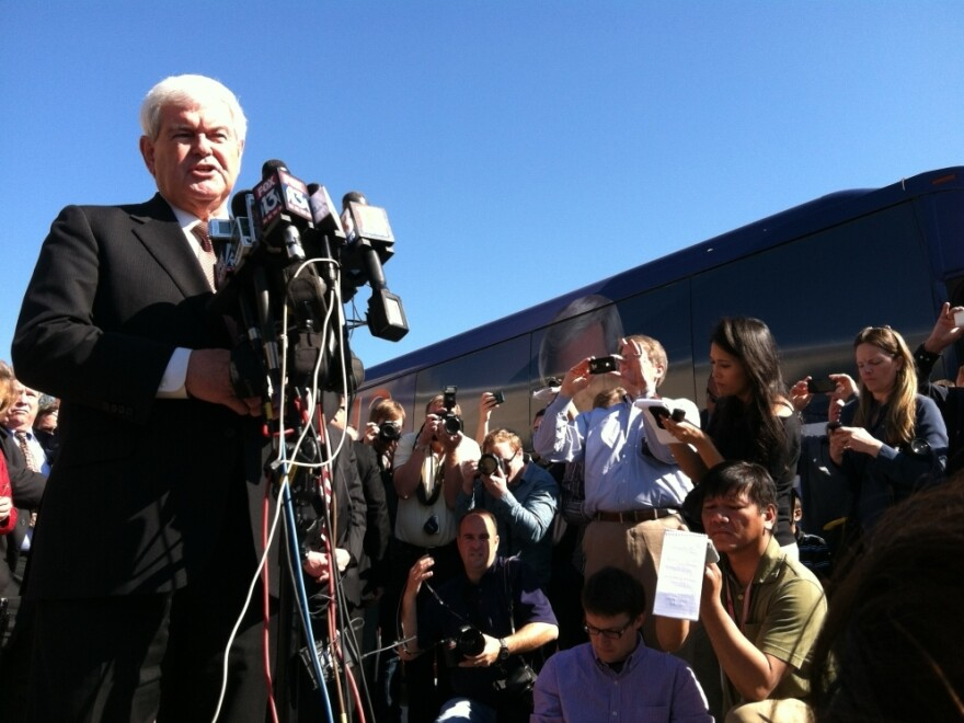 Republican presidential candidate Newt Gingrich speaks to reporters in Lutz, Fla., on Sunday. The former House speaker is trailing Mitt Romney in polls ahead of Tuesday's primary in the Sunshine State.