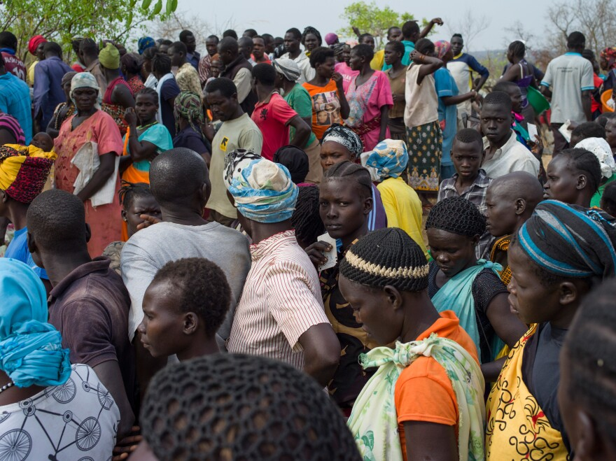 Families wait in line as the World Food Program prepares to deliver food aid at the Bidi Bidi refugee camp on Feb. 22 in Arua, Uganda. The continued flow of refugees from South Sudan has pushed the camp's population to more than 270,000.