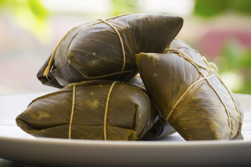 Panamanian tamales stuffed with chicken and wrapped in <em>bijao</em> leaves — one of hundreds of interpretations of the dish found throughout Latin America.