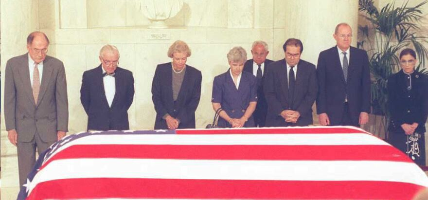 Supreme Court Justices pay their respects in front of the casket of former Justice Warren E. Burger in 1995. From the left are Justices William Rehnquist, John Paul Stevens, Sandra Day O'Connor, Mrs. Lewis Powell, wife of a retired justice, Justices Antonin Scalia, Anthony Kennedy and Ruth Bader Ginsburg.