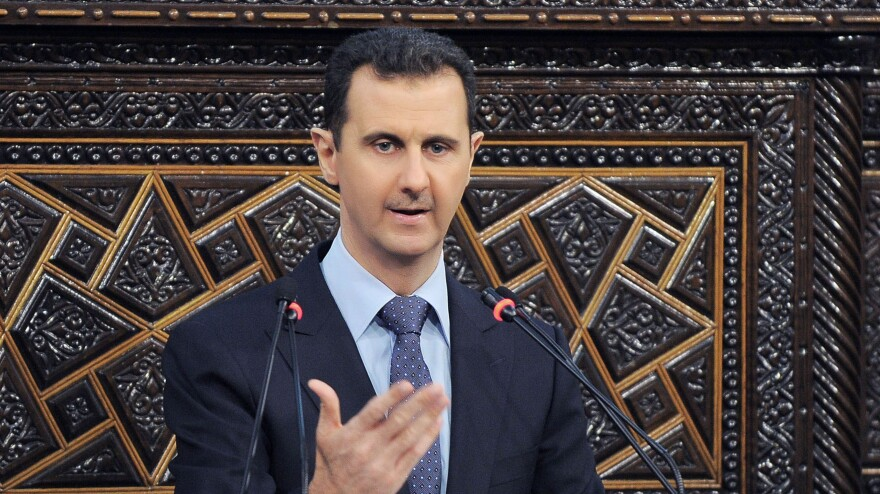 President Bashar Assad addresses Parliament on June 3. Syrians in the capital, Damascus, have become more willing to speak out, though they still don't want to be identified by name. Many feel the Assad regime is losing control of parts of the country.