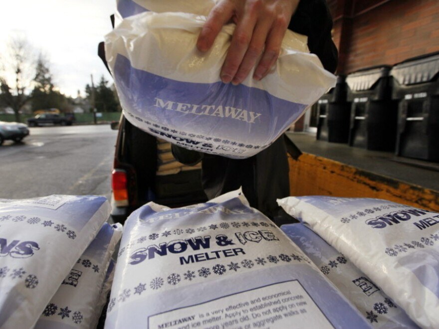 Bags of a deicing product were being stacked outside a hardware store in Seattle on Tuesday, as folks prepared for today's bad weather.