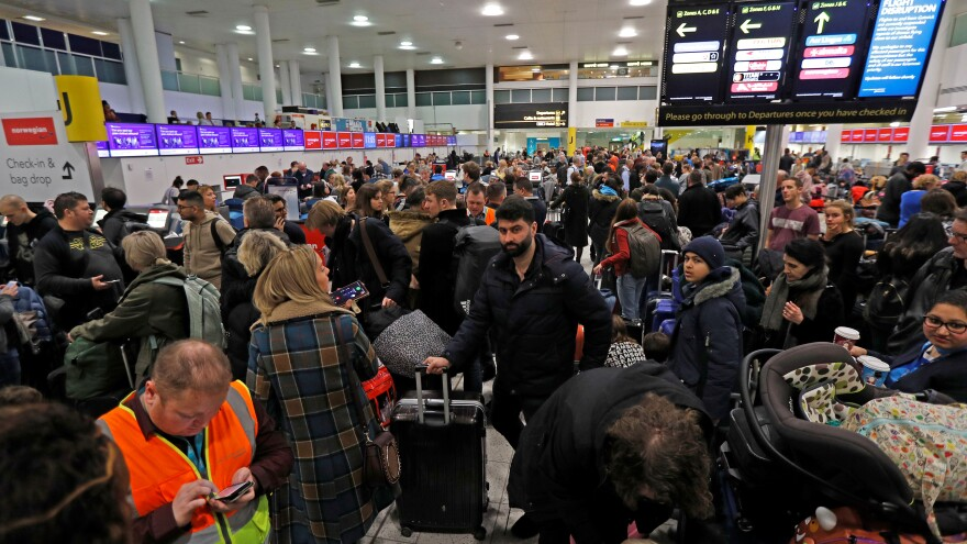 Passengers wait Thursday after Gatwick Airport was forced to shut down operations because of drones flown illegally over its airfield.