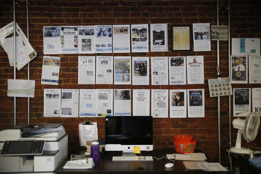 A wall in <em>The Daily Tar Heel</em>'s newsroom is lined with memorable headlines.