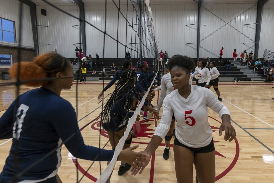 Junior co-captain Renee Hall shakes hands with Clyde C. Miller Academy players after losing their first home match is school history Wednesday, Sept. 26, 2018.
