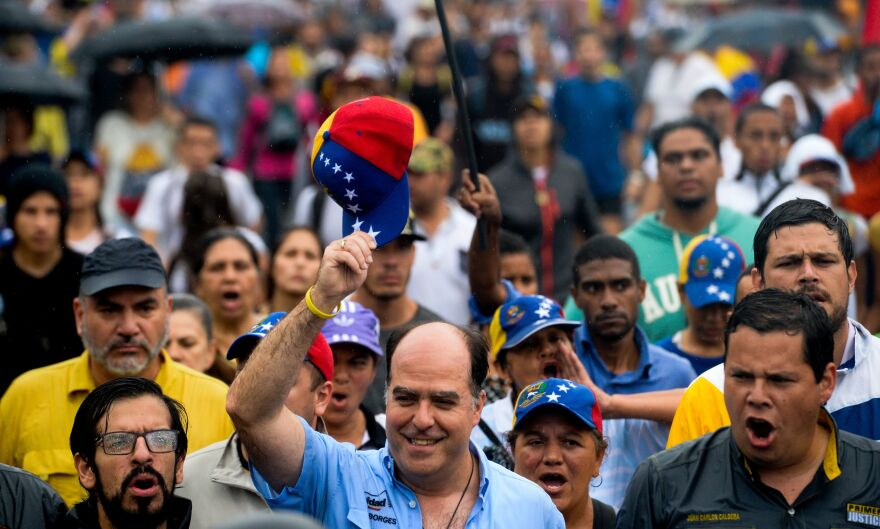 Julio Borges, president of Venezuela's National Assembly, acknowledges the crowd during a rally against Maduro on Thursday.