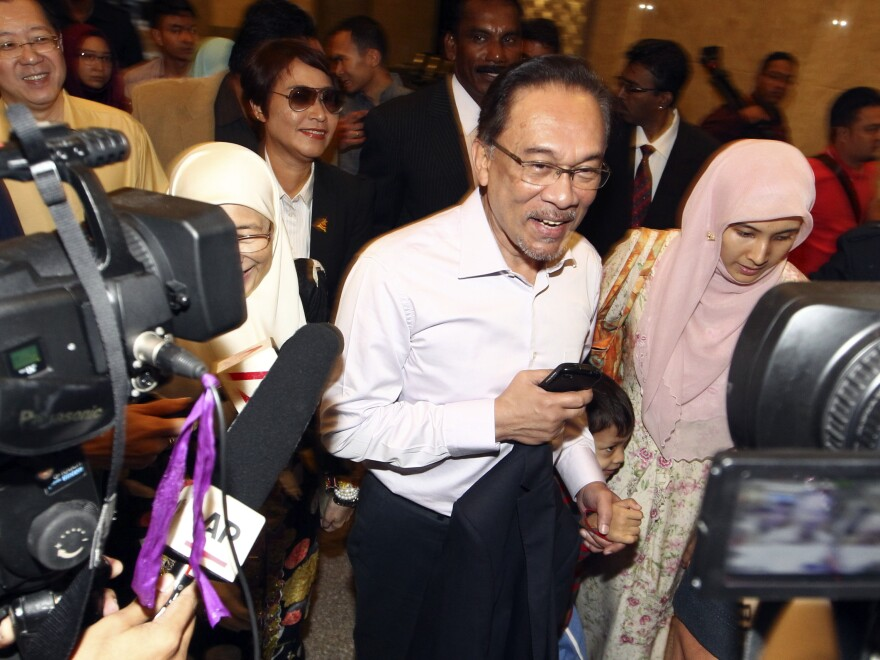 Malaysian opposition leader Anwar Ibrahim arrives at court house in Putrajaya, Malaysia, on Tuesday. Malaysia's top court upheld Anwar's sodomy conviction in a case widely seen as politically motivated.