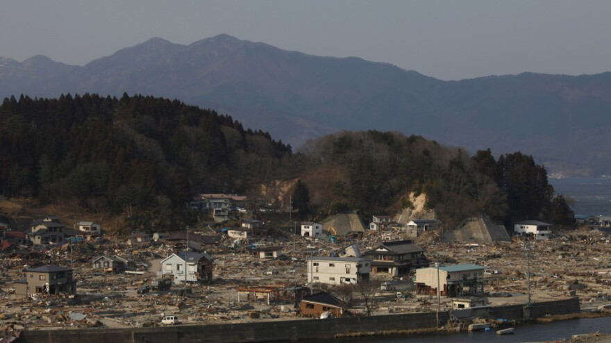 Damaged homes stand in the debris at the tsunami-destroyed town of Yamada, Japan. The government will soon decide whether it will rebuild towns like Yamada or move residents elsewhere. Relocation, if it happens, will be hardest on the elderly.