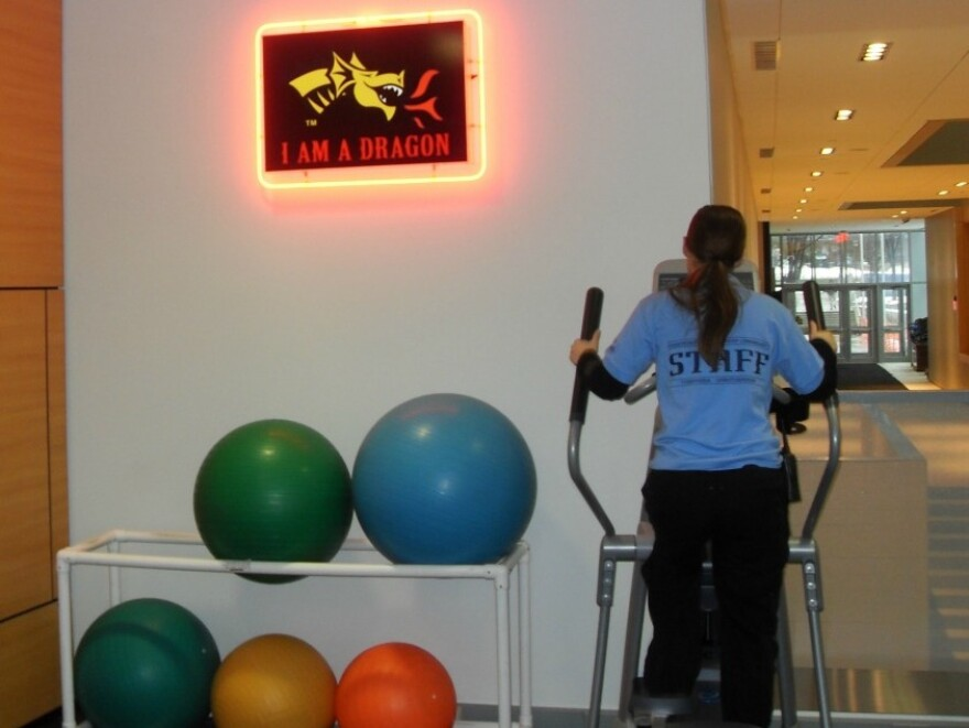 An elliptical at Drexel University's athletic facility powers an electric sign.
