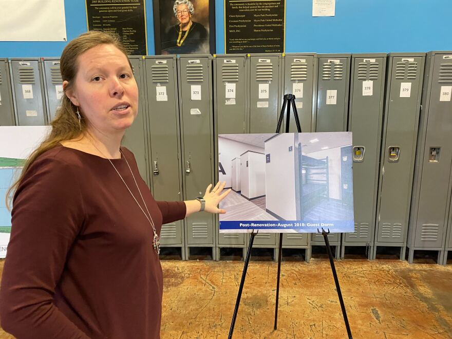 Liz Clasen-Kelly, CEO of the Men's Shelter of Charlotte/Urban Ministry Center, explains the bed layout for the new shelter, in this file photo from January 2020.