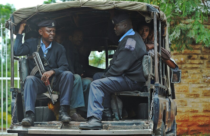 Kenyan security officers rounded up people Friday as part of a crackdown that has swept up thousands of undocumented refugees, immigrants and Kenyan citizens of Somali descent in recent weeks.