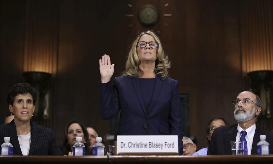 Christine Blasey Ford is sworn in before the Senate panel on Thursday.