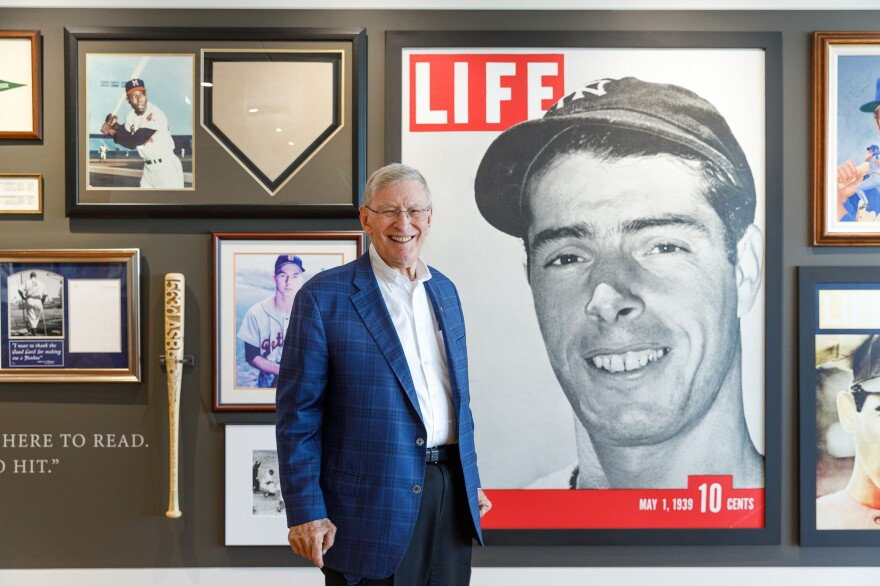 """Selig stands next to a wall display in his office of New York Yankees legend Joe DiMaggio. """"Well there's nothing like Cooperstown,"""" he says, """"but this is pretty close."""""""